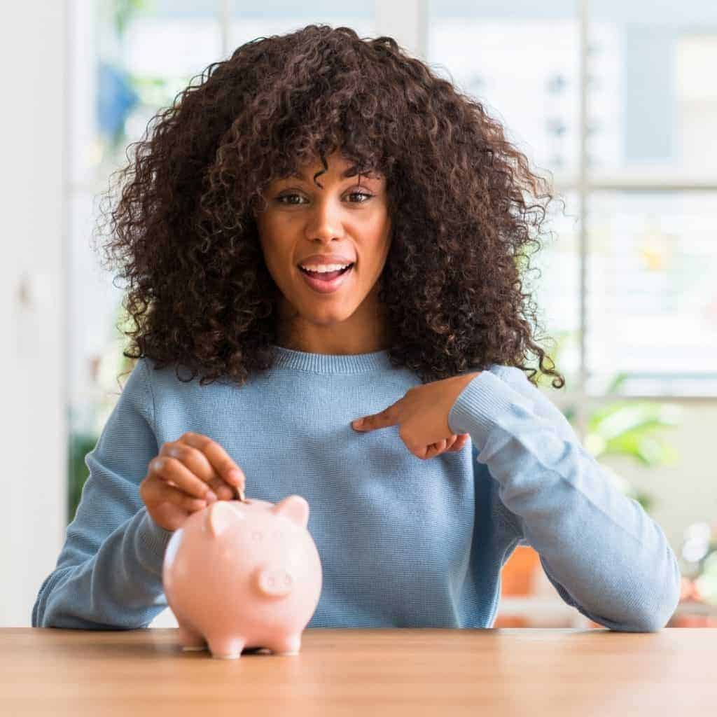 lady pointing at piggy bank