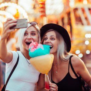 women taking selfie at amusement park